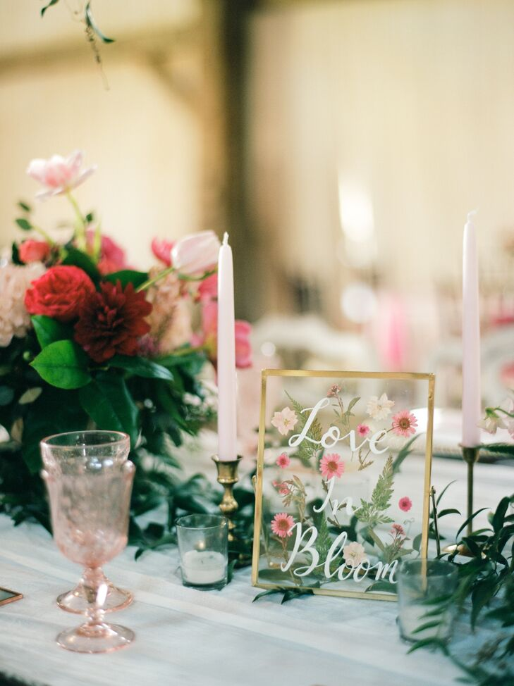 """""""To incorporate our floral 'Love in bloom' theme, we made individually pressed flower coasters with our guests' names and table numbers as escort cards, which doubled as favors,"""" Deborah says."""