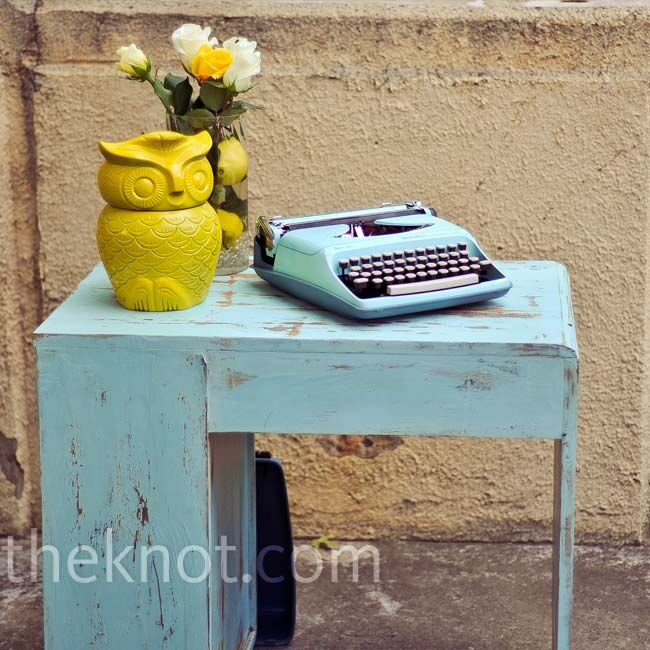 A vintage owl cookie jar and an antique typewriter added some character to the guest book table.