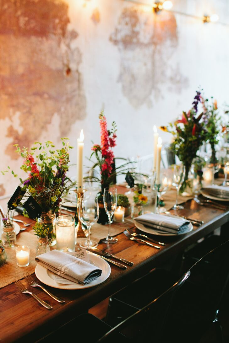 Rustic Farm Table with Candles and Red Flowers