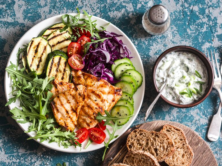 Mediterranean diet salad and bread on a blue background