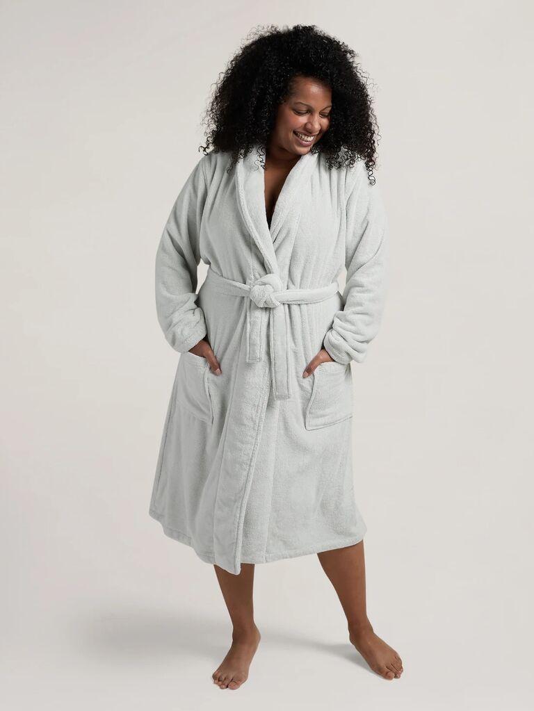 Plus size model wearing plush light gray bathrobe