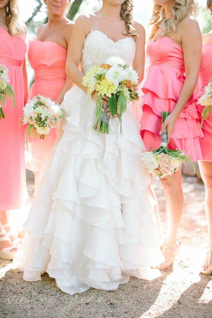 Jennifer and her bridesmaids carried bouquets filled dahlias, hypernicum berries and pincushion flowers in yellow, white, orange and pink.