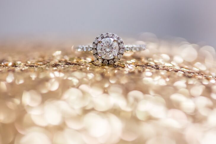 Taylor's engagement ring is quite the sparkler! It features a round diamond with 16 pave diamonds in the halo and a pave diamond band.
