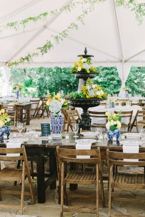 Elegant Tented Reception with Chinoiserie Vases and Wooden Folding Chairs