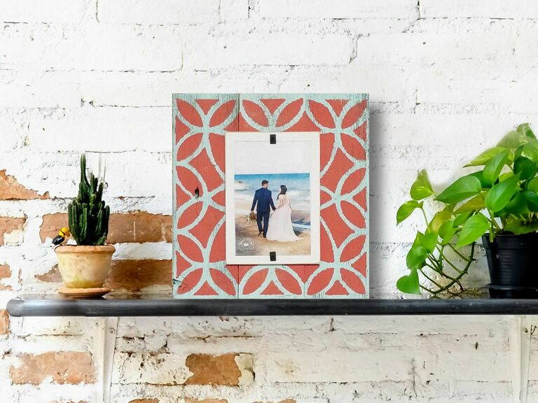 Rustic wooden coral-hued picture frame with wedding photo inside