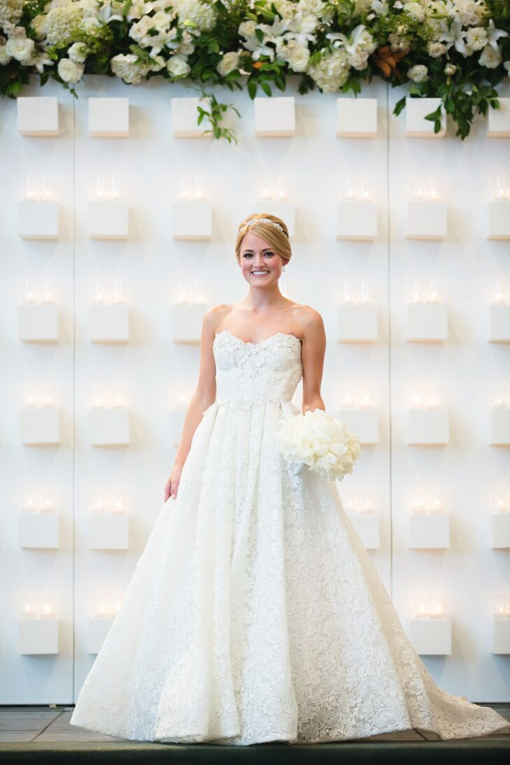 Kelly's dress was gorgeous, and it fit her perfectly. She wore a Pnina Tornai ball gown wedding dress with intricate lace details and crystal appliques around the neckline. She completed her chic style with a silver and ivory ribbon headpiece with crystal details by Maria Elena.