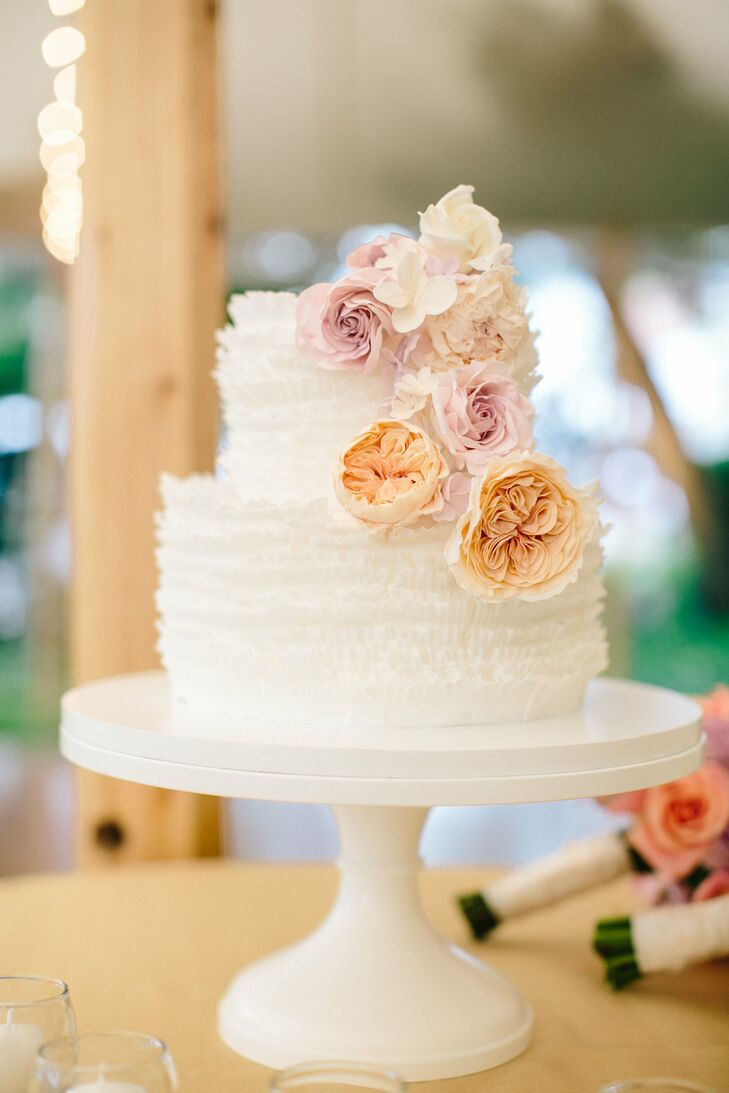 """""""I wanted a soft, delicate, simple look to the cake,"""" Carey says. """"The sugar flowers were absolutely stunning and artistic!"""""""