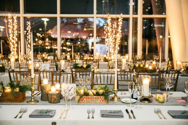Centerpieces at the reception consisted of vintage wooden boxes filled with pine and votive candles in gold holders.