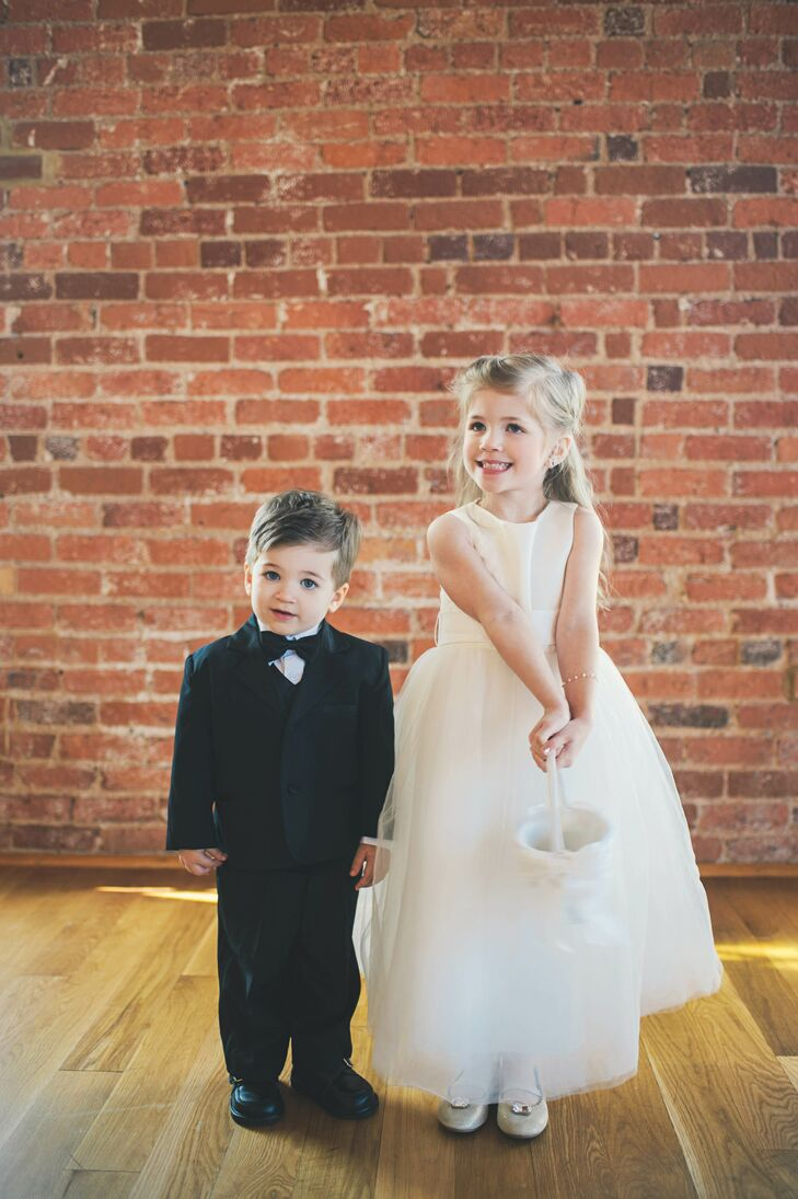 The flower girl wore a white dress from David's Bridal with sparkly silver shoes and the ring bearer sported a tux from Men's Wearhouse. They walked down the aisle together tossing flower petals out of a little white basket.