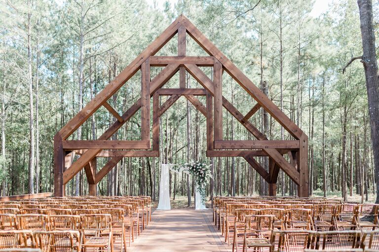 Outdoor wedding ceremony space with wood chapel-like structure