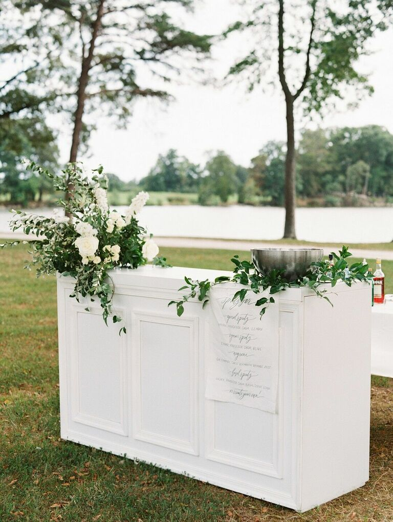 White bar front covered with greenery
