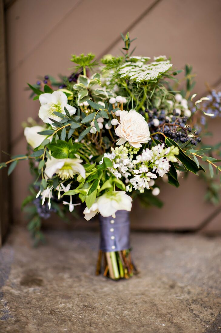 Garden roses, lilac, black currants, queen anne's lace and a mix of greenery gave Katie's bridal bouquet a rustic edge.