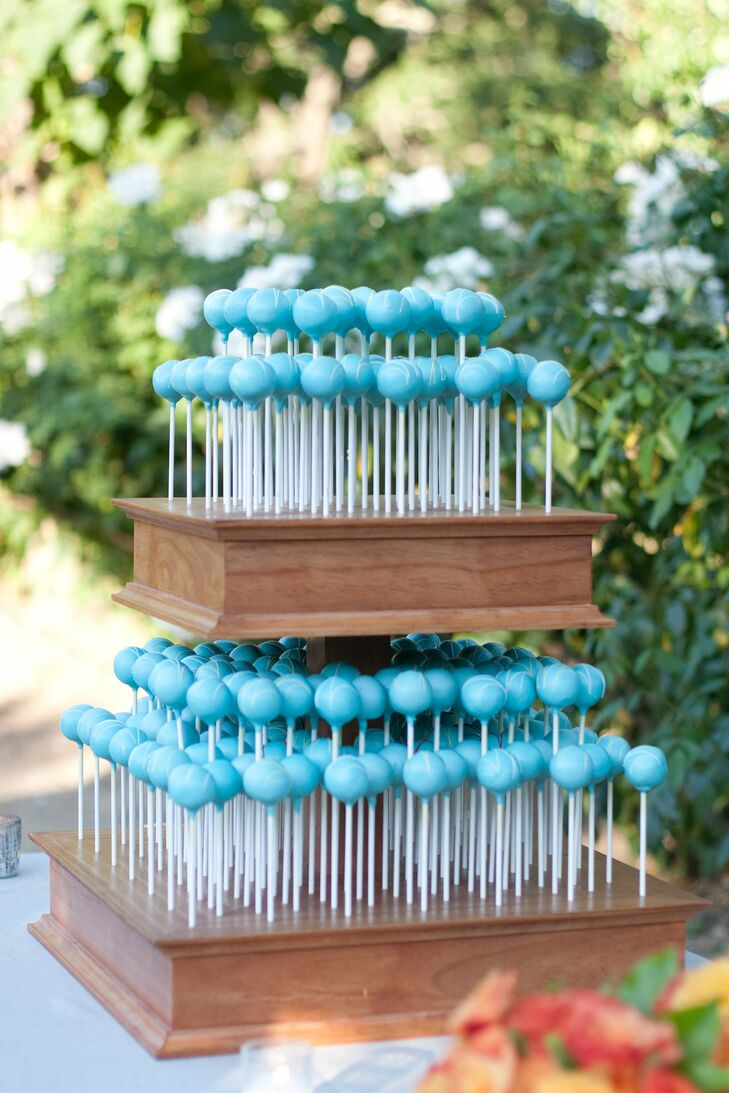 For a cute twist on tradition, turquoise cake pops were arranged to mimic the tiers of a classic wedding cake.