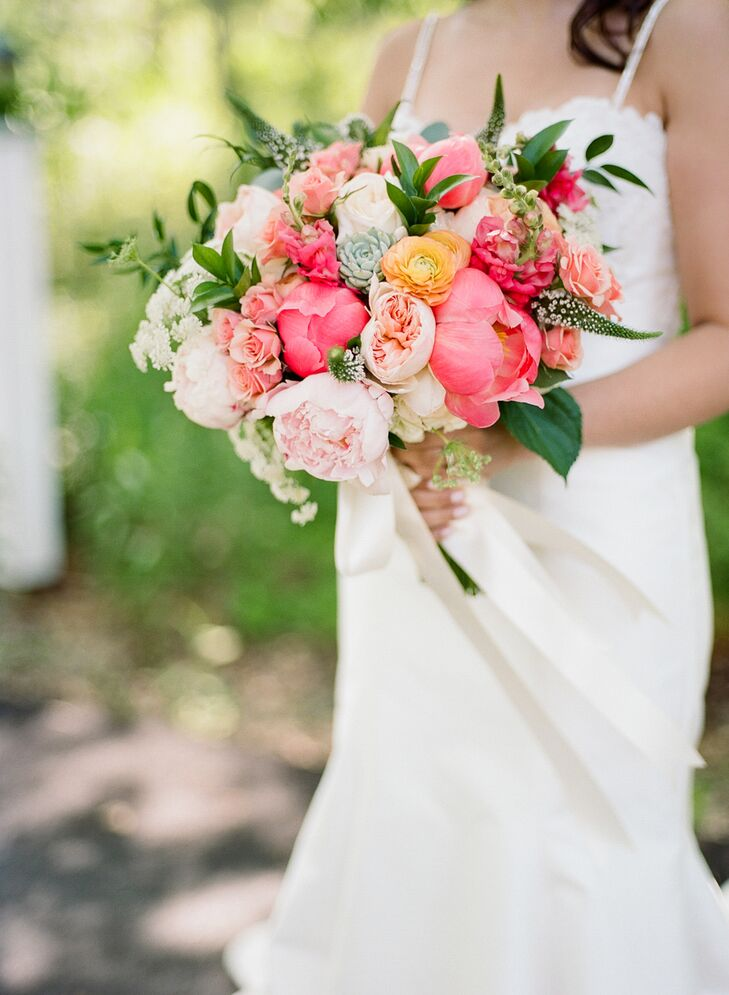 """""""Our flowers were pretty simple and minimal because our landscape and backdrop were so lush and beautiful on their own,"""" Jamie says. """"I love peonies—they go perfectly with Kate Spade—so we absolutely had to have those, and the garden roses added a nice balance."""" The bride's bouquet also incorporated wildflowers native to Maine and succulents for texture."""