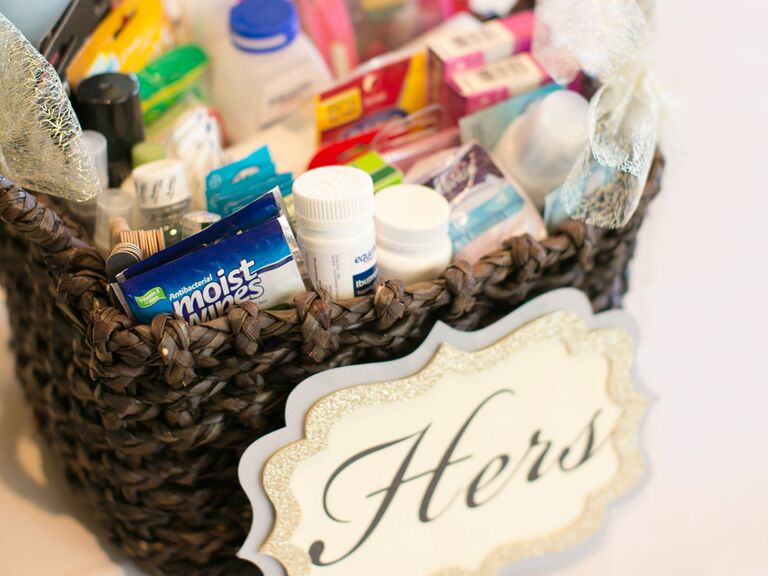 wicker basket filled with bathroom amenities for women at wedding - Bathroom Baskets