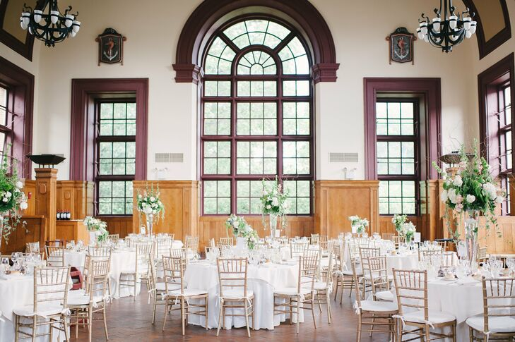 The decor at the reception was chosen to compliment the historic nature of the hall with ivory table linens and tall centerpieces to echo its height and grandeur.