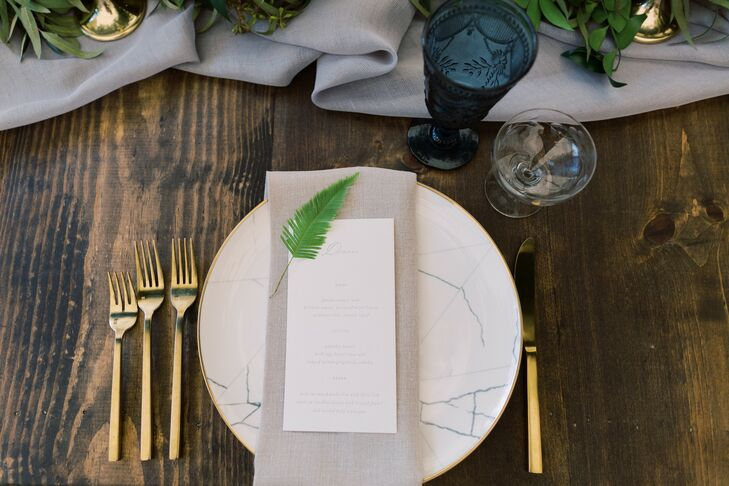 Rustic Place Setting with Marbled Dinnerware, Gold Flatware and Menu