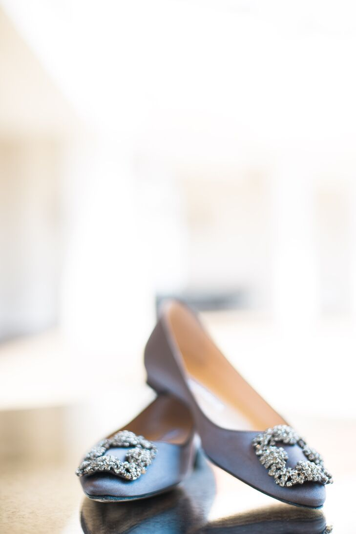 During the ceremony, Millie walked down the aisle in a metallic Jimmy Choo sandal heel. TShe changed into classic pewter Manolo Blahnik flats with broach details for comfort and dancing during the reception.