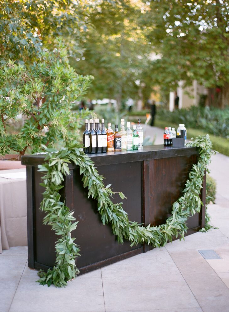 A lush olive and bay leaf garland was draped over the dark wooden bar.