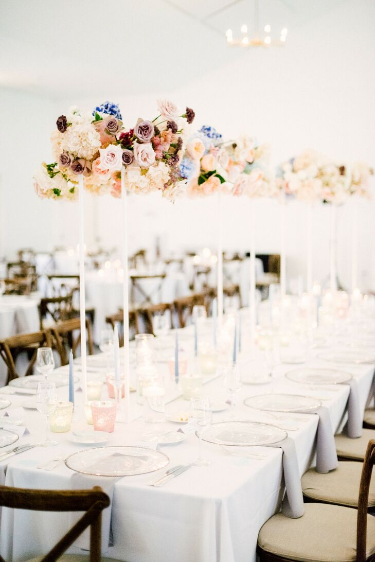 Dining Table with White Linens and Tall Floral Centerpieces