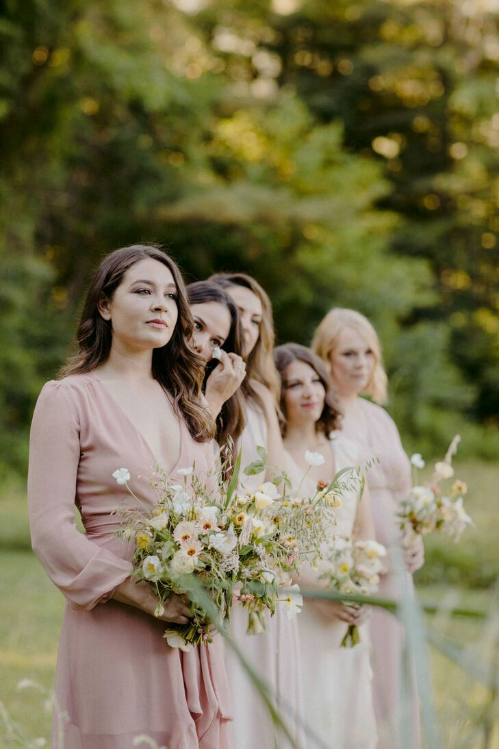 Romantic Bridesmaids with Pink Dresses and Whimsical Bouquets