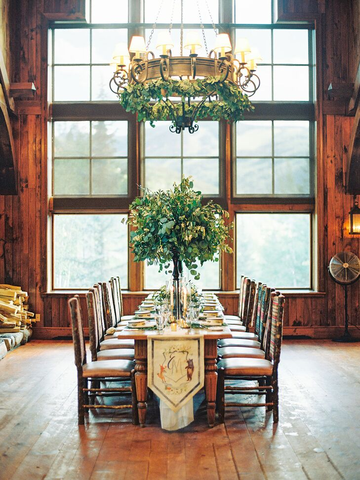 Rustic Reception with Wood Walls and Tall Centerpieces