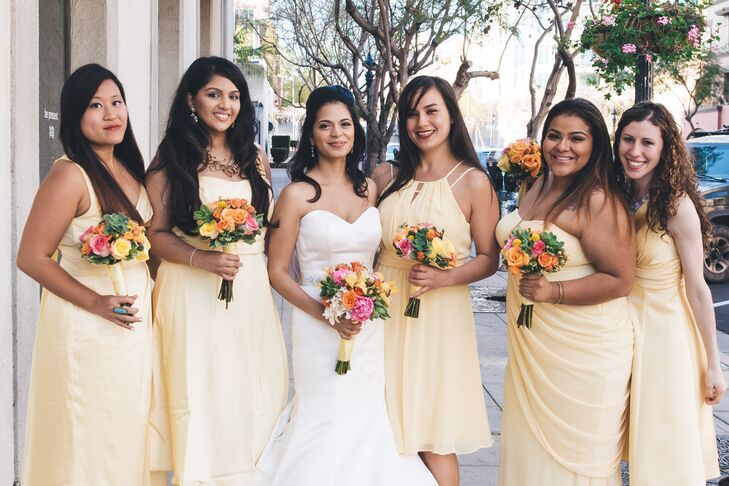 """""""The bridesmaids wore a warm yellow from David's Bridal, all in different styles for the ladies to chose what they were comfortable in,"""" says Jess."""