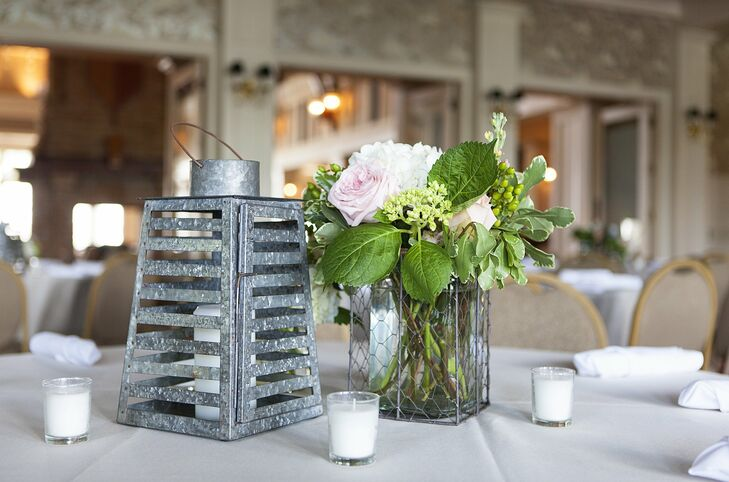 Rustic metal lanterns were paired with textured arrangements of pink and white hydrangeas and roses on the guest tables.