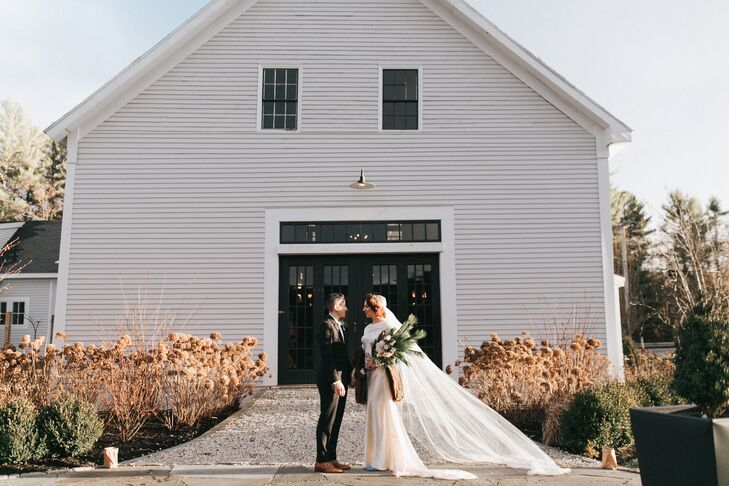 "Flanagan Farm in Buxton, Maine, offered the ideal backdrop for the personality-packed fete, with its tranquil natural setting and quaint white barn. ""Because of the unpredictable New England weather in December, we wanted to keep folks in one location,"" Lexie says. ""The space at the Barn at Flanagan Farm was the perfect size and canvas. We were able to amortize the entire property, including having first looks in the woods, the ceremony and reception in the main barn and the house for ourselves and guests as a getaway for the weekend."""