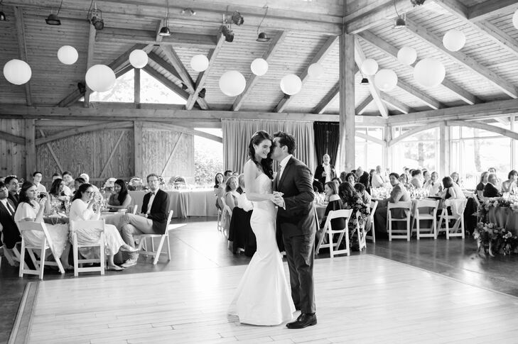 "After cocktails, guests were ushered into the lodge for the reception at Onteora Mountain House in Boiceville, New York. Before tucking into dinner, Julia and Lucas shared their first dance to the tune of ""Over the Rainbow."""