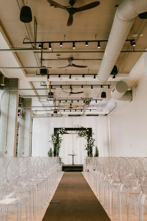 Modern Industrial Loft Ceremony with Ghost Chairs and Chuppah at The Ben in West Palm Beach, Florida