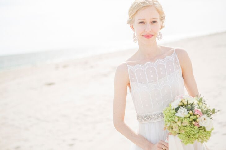 Aubrey paired her vintage wedding dress with a classic red lip and and soft updo.