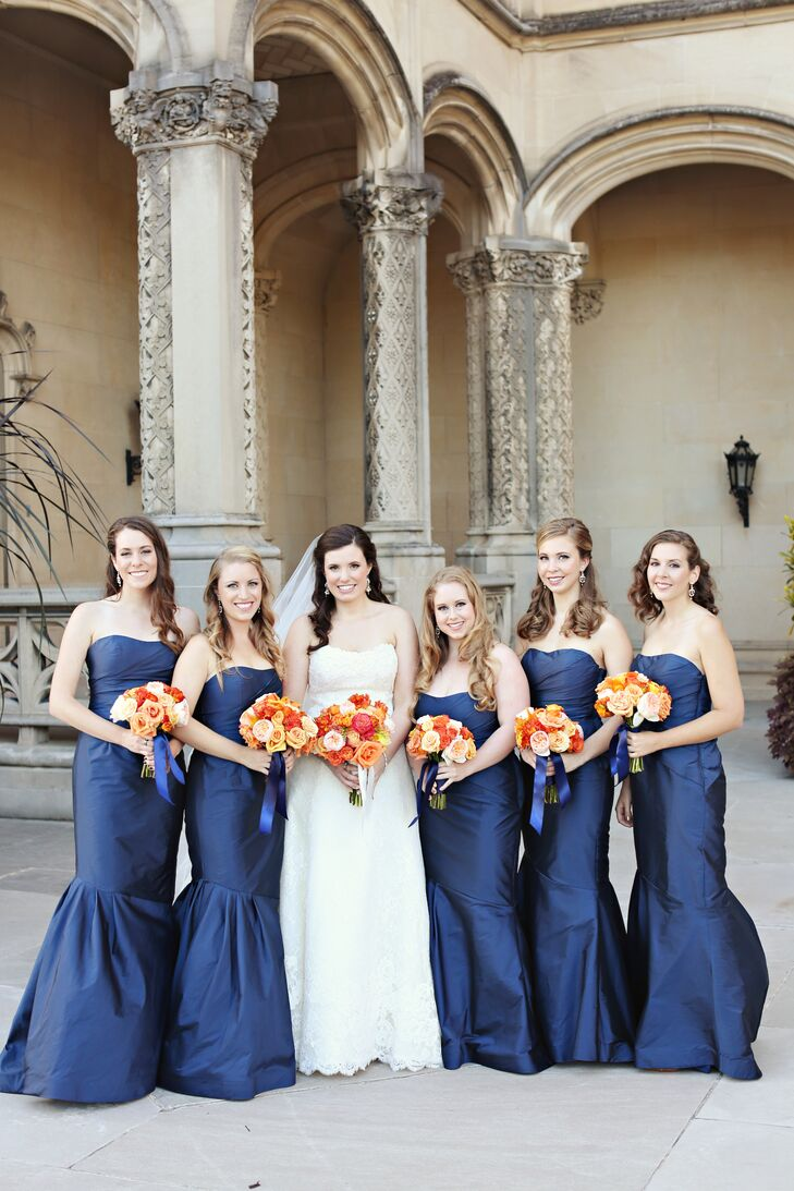 """My bridesmaids tried on this gorgeous sample dress and how it fit all of them I have no idea considering they're all completely different heights—it was like the sisterhood of the traveling dress,"" says Kathryn. ""We went with the navy blue Monique Lhuillier dress that literally looked dropped dead gorgeous on all of them—I wish I had one myself!"""