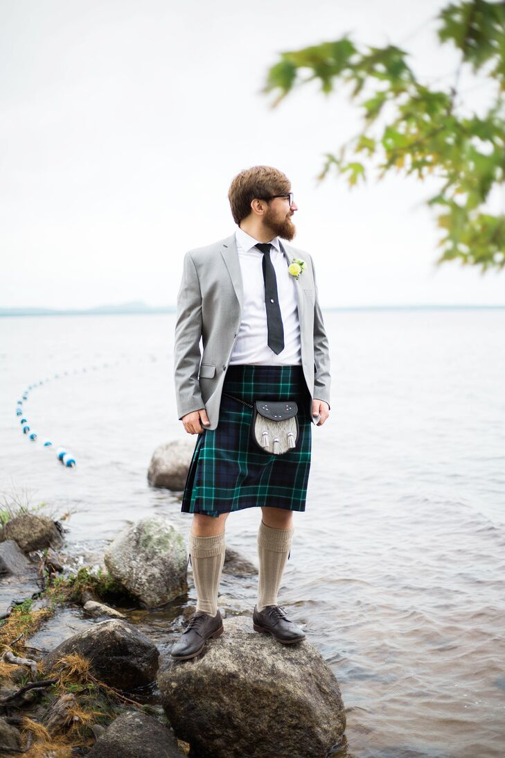 As a nod to his Scottish roots and Emma's recent year abroad in Glasgow, Graham ditched the expected suit, opting instead to rock his family's tartan. He paired the traditional threads with brogues, knee-high socks, a sporran, a light gray jacket, a white button-down and a black tie. As a special touch, he adorned his tie with a tie pin from Emma and embellished his boutonniere with a luckenbooth brooch he had given to Emma during high school.