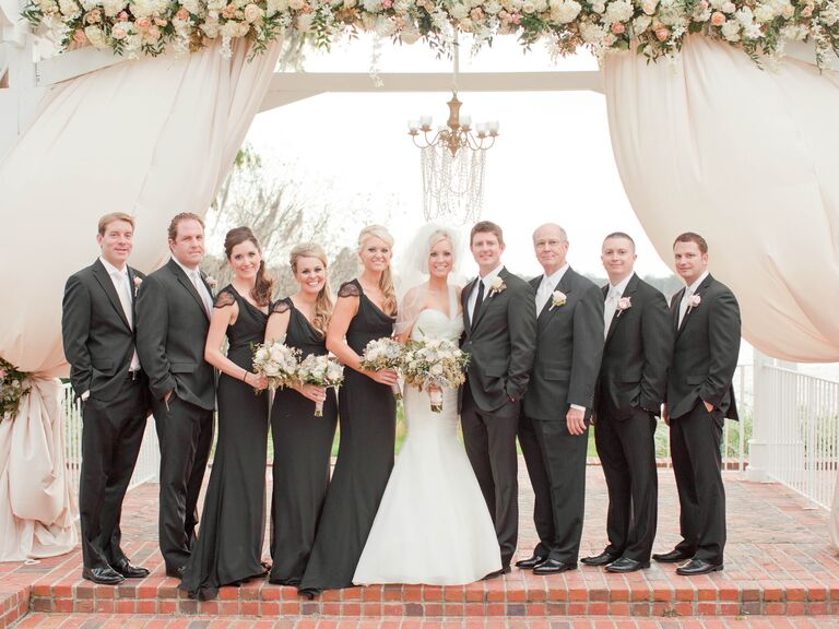 Uneven number of bridesmaids and groomsmen all wearing black.