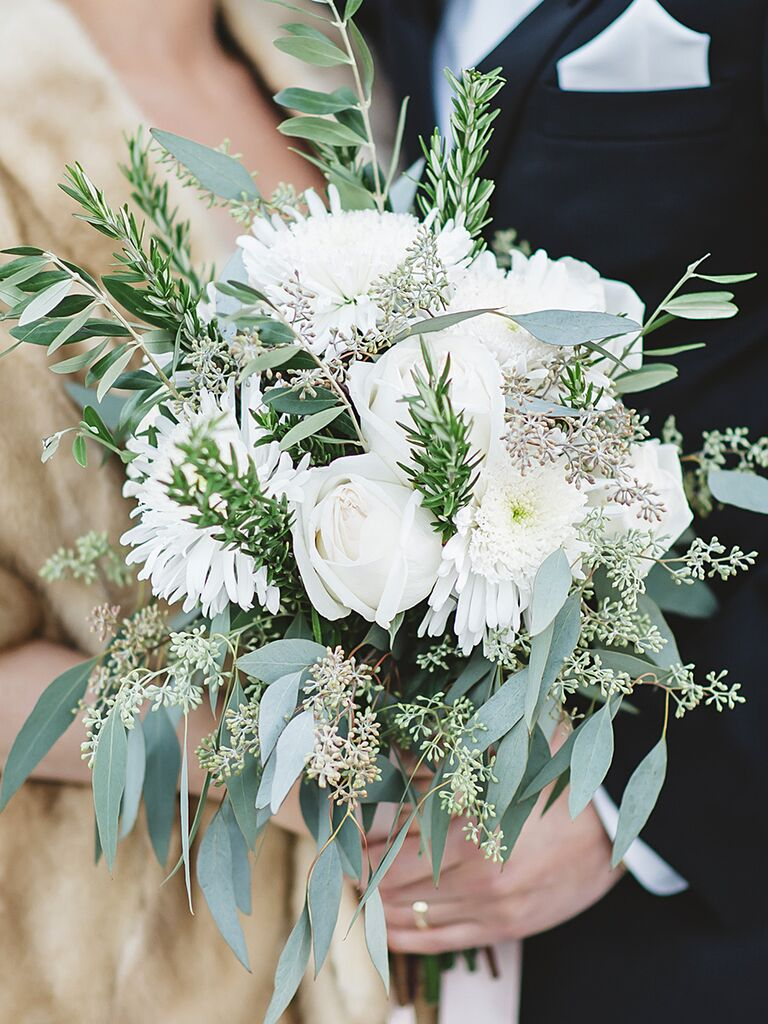 The prettiest greenery bouquets weve ever seen a bridal bouquet with roses and fresh herbs izmirmasajfo