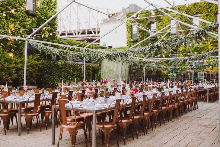 String lights illuminated the metal canopy over the reception space and kept the industrial feel of the otherwise garden-inspired courtyard. The same Marais-style chairs from the ceremony transformed the long feasting tables into a cozy yet minimalist space.