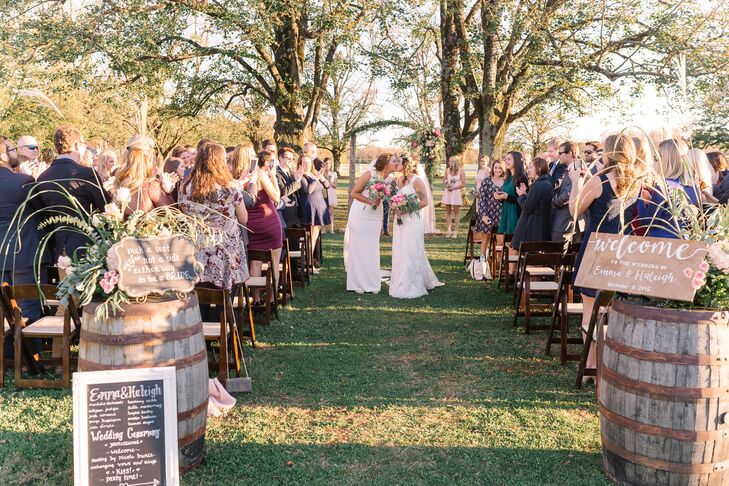 """The couple wrote their ceremony script, and their friend Daniel officiated. """"I tried to incorporate old traditional elements and new ideas when it came to what was said, but it wasn't specific to any religion or culture,"""" Emma says. """"It mostly focused on the love and unity of two people."""""""