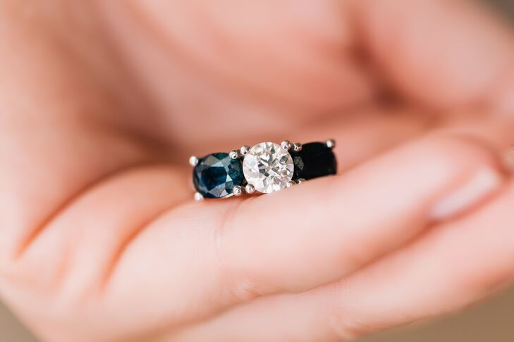 Mary Claire's mother-in-law took off the family ring when William proposed to immediately pass it on to her. The setting has been changed to add sapphires, but the diamond itself has been a family heirloom since the 1800s.