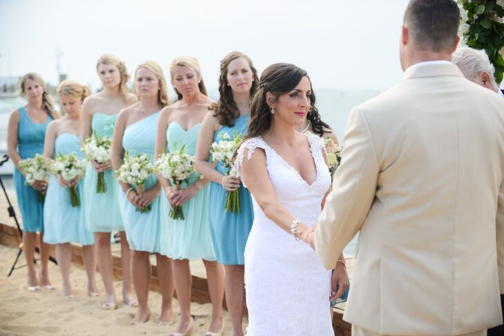 "Caitlin's bridesmaids wore Donna Morgan silk chiffon dresses in four different shades of aqua. ""I wanted my sister, the matron of honor to stand out, so I let her have her own shade,"" says Caitlin. ""The rest of them wore assigned hues of aqua for a result that resembled an assortment of beach glass."""