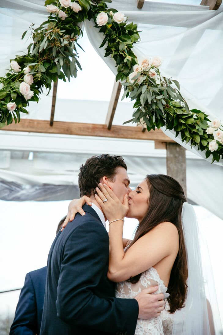 """Mike was in charge of his and the groomsmen's looks so he went for something dapper and a little bold.  """"He has great style, so I totally trusted him on this!"""" says Jenna. He wore a dark navy suit by Theory with a pink tie and matching rose boutonniere. His groomsmen wore their own navy suits."""