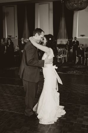 The Bride and Groom Have their First Dance in Black and White
