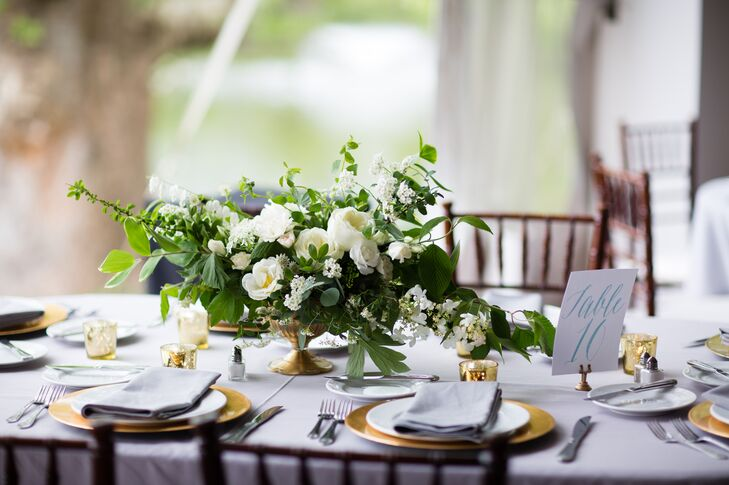 Though Austin, Texas-based couple Caitlin and Hugh hosted their nuptials  in Ambler, Pennsylvania, the day wouldn't have been complete without a little Southern charm. To give the day a classic, traditional feel, the pair chose a soft palette of ivory, gold, gray and green, and filled the Manor House at Prophecy Creek with lush arrangements of ivory and white blooms.
