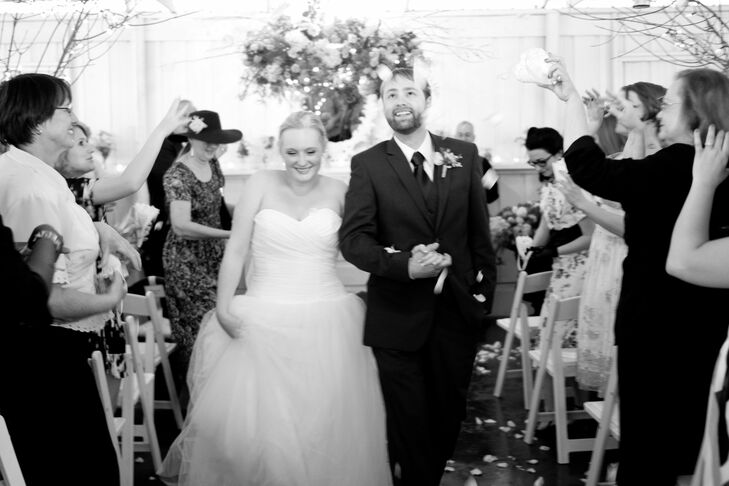 Guests threw rose petals over the newlyweds as they made their way back up the aisle.