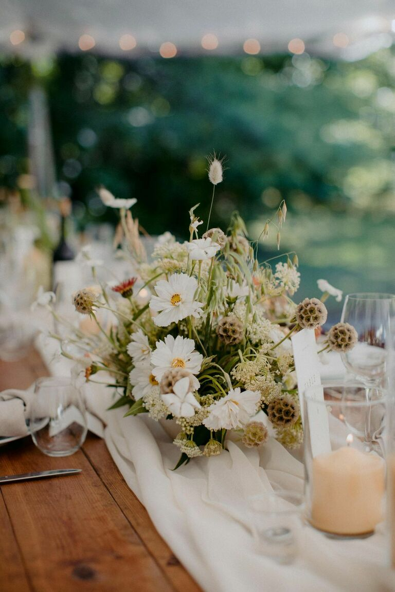 Rustic centerpiece with brown foliage and white cosmo blooms