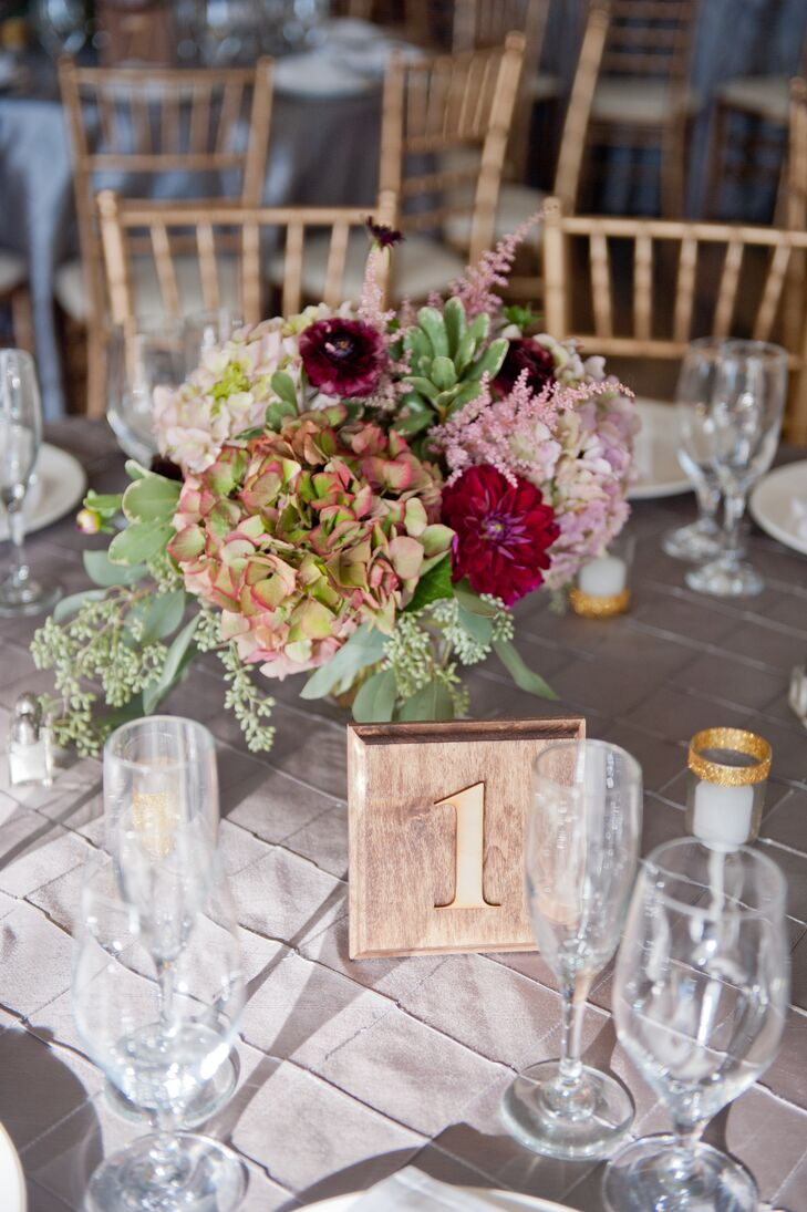 Centerpieces at the reception consisted of flower arrangements with red dahlias, pink, green and white hydrangeas and pink astilbes.