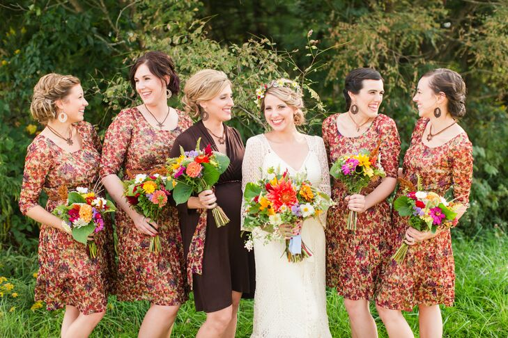 The bridesmaids wore busy floral-patterned dresses with a mix of orange, red, purple and green. The girls had brown belts wrapped around their waists, and Caryln made the dangling hoop earrings and necklaces for all the bridesmaids to wear.