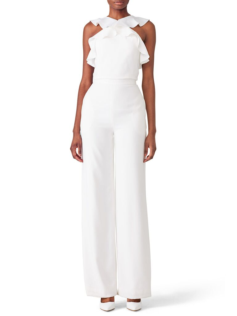 White jumpsuit with flutter halter neckline