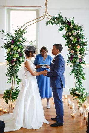 Indoor Ceremony Under a Greenery Arch