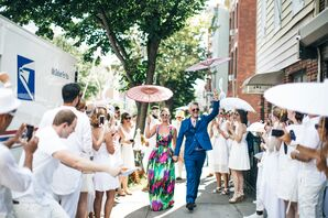 Whimsical Couple Carrying Parasols on the Way to Reception